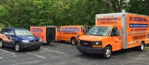 Water Damage Restoration Vehicles At Commercial Property